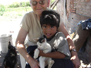 Sr. Stephanie holding a young child in Clodomira.